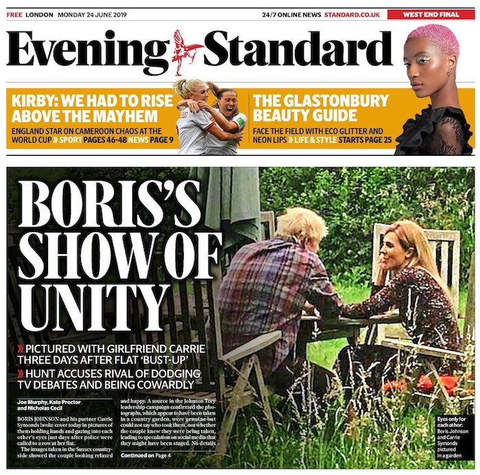 "A front page of the Evening Standard, with the headline ""Boris's show of unity"" with a picture of Johnson and his girlfriend Carrie Symonds, sitting on wooden chairs in a garden looking at each other."