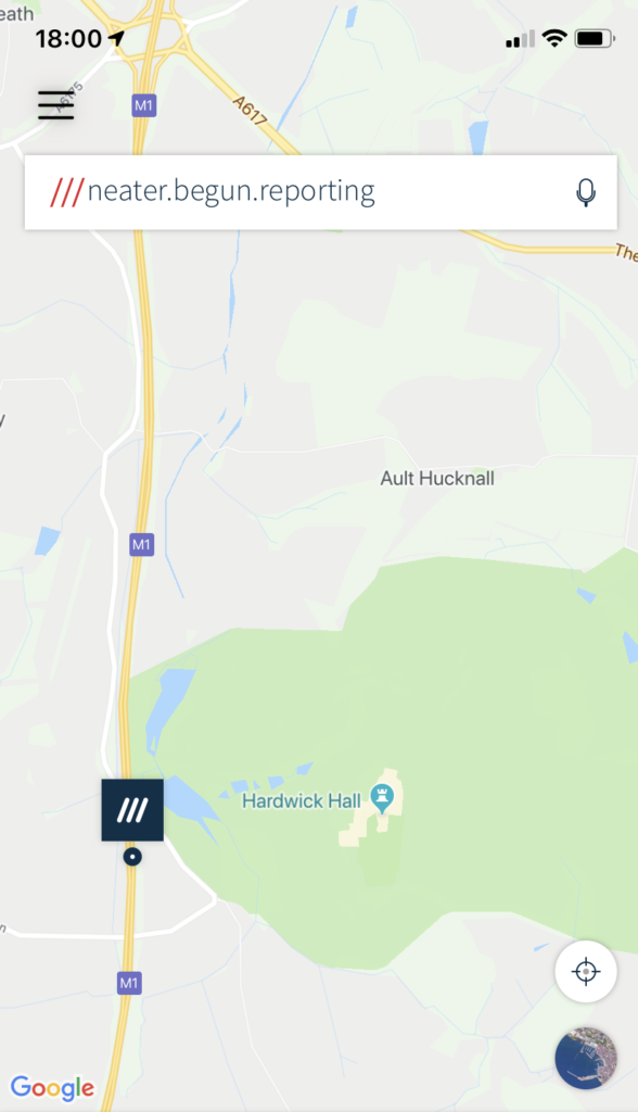 "An iPhone screenshot of What3Words, showing a stretch of the M1 running north to south outside the grounds of Hardwick Hall. There is a dark blue dot with a square showing three slashes, and near the top is a box showing the words ""neater, begun, reporting""."