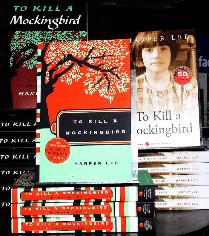 "A picture of three stacks of three different editions of ""To Kill a Mockingbird"", of which one has a sticker advertising Harper Lee's other book, ""Go Set a Watchman"", to be released July 2015."