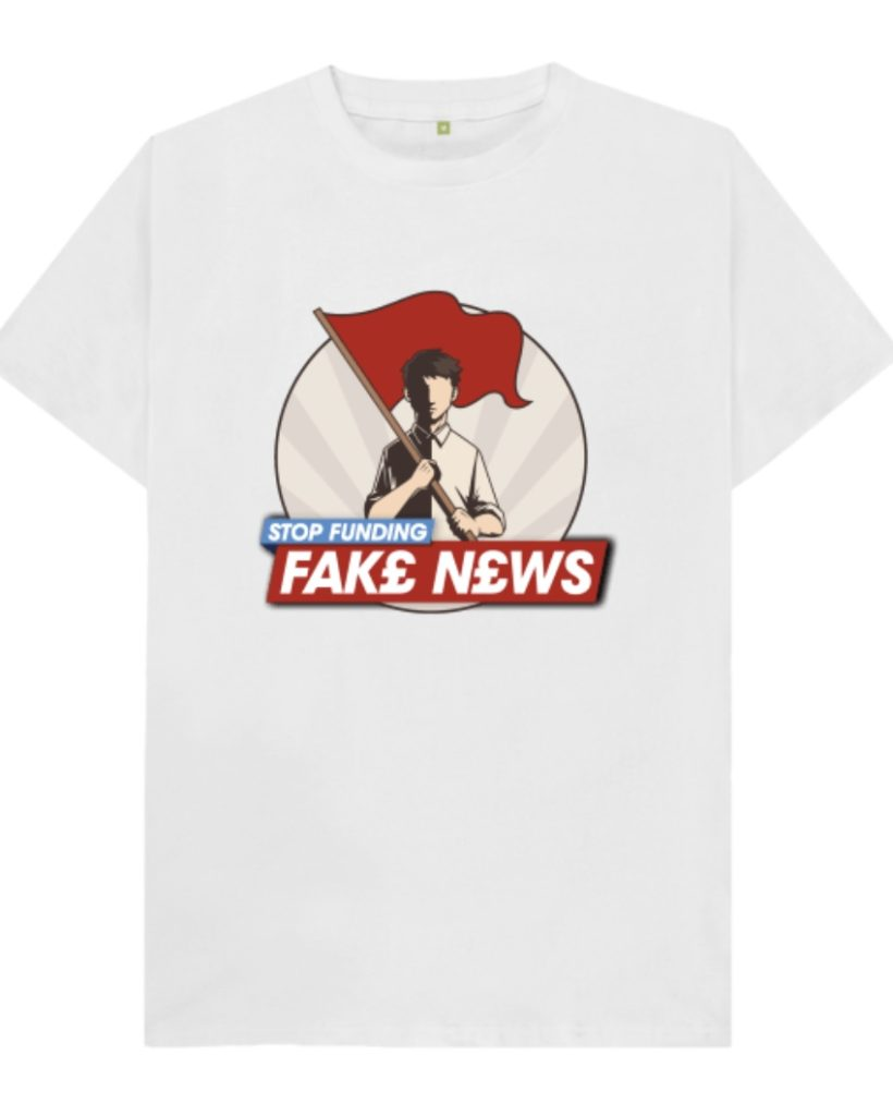 "A picture of a white T-shirt with a logo reading ""Stop funding fake news"" underneath a man in a two-tone beige/brown shirt holding a red flag in his hand"