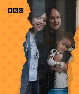 Picture of two young white women with a young white girl standing in front of them. The image is framed by an orange and red pattern with the BBC logo at top left.